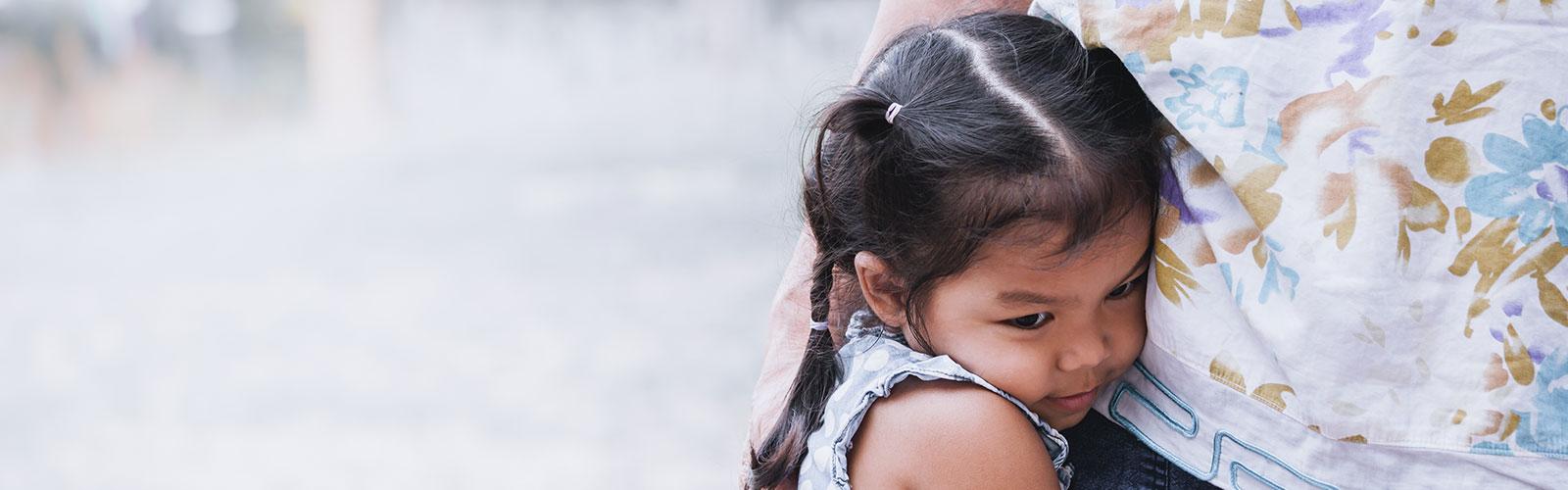 Child hugs parent