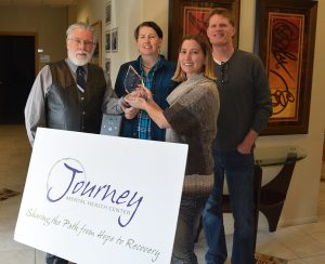 Journey Mental Health accepts an award for helping their patients live tobacco-free.