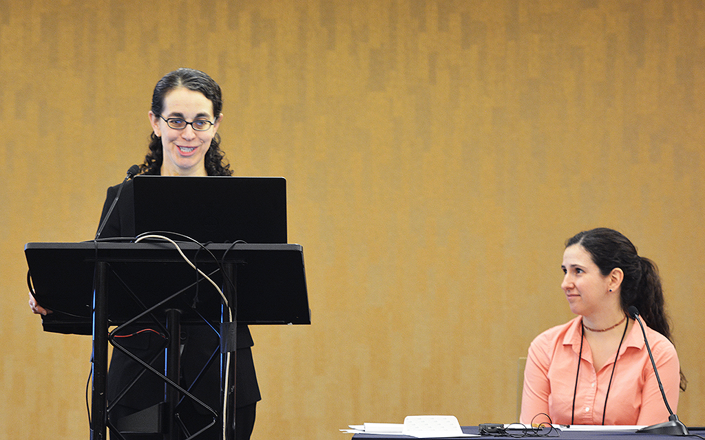 UW-CTRI Researcher Dr. Tanya Schlam (left) presents research findings during an SRNT symposium in San Francisco moderated by UW-CTRI Researcher Madeline Oguss (right). Oguss also presented.