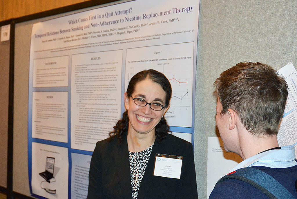 Dr. Tanya Schlam (left) enjoys a bit of levity during her poster session with a fellow SRNT attendee.