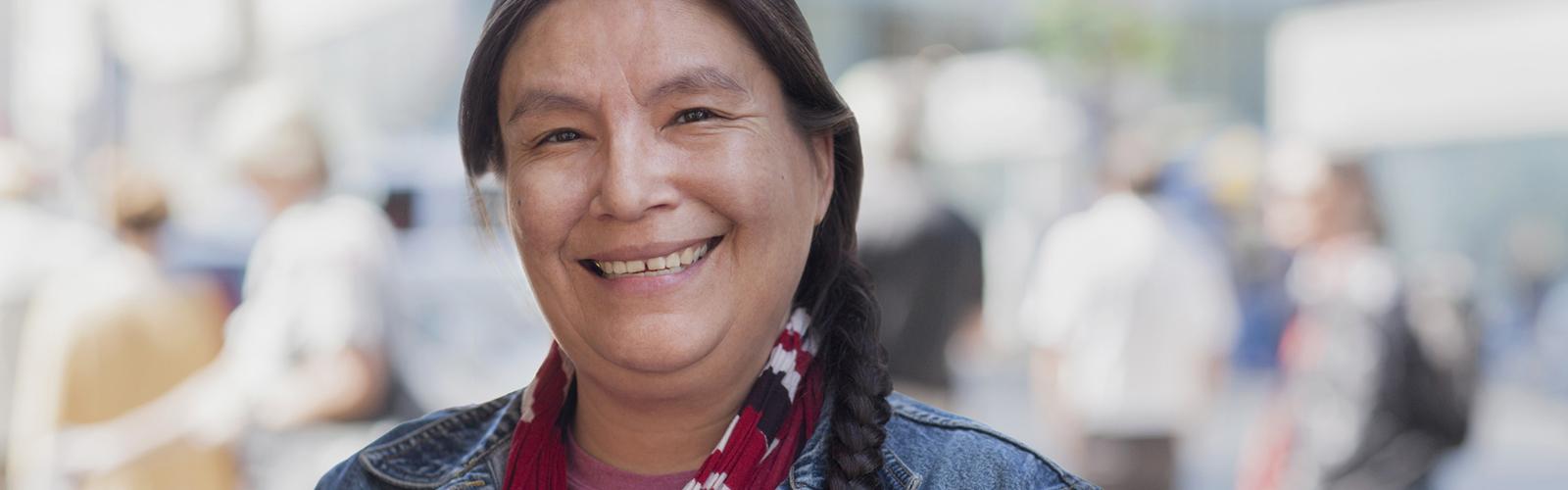 Native American woman smiles