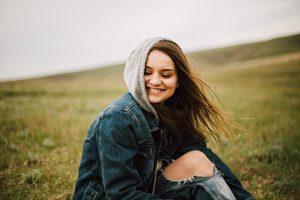 Teen in hoodie smiling
