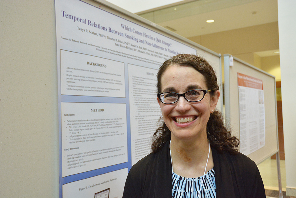 Dr. Tanya Schlam with her award-winning poster